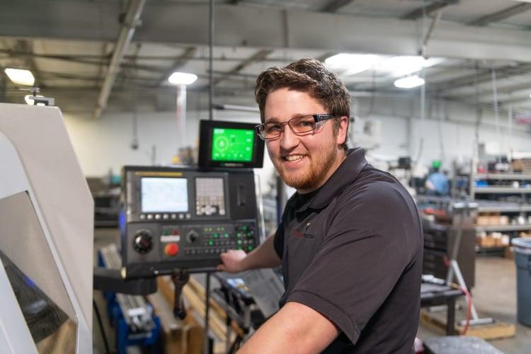 Operator Smiling at Machine.