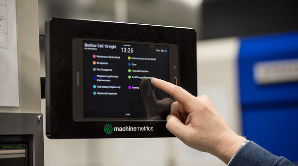 Hand Reaching Out to Touch a MachineMetrics Tablet