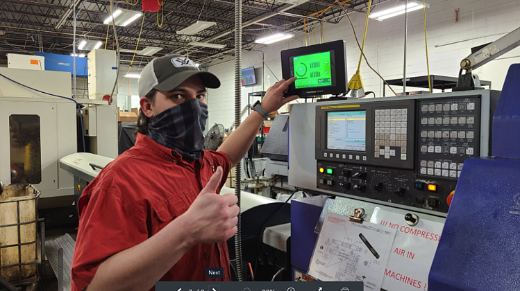 A Quality Manager Giving a Thumb's Up Near a CNC Machine